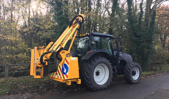 200hp Valtra with an 8 meter side arm flail